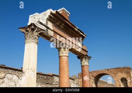 Corinthian columns at the temple of Jupiter, via del foro, historic town of Pompeii in the Gulf of Naples, Italy, - Stock Photo