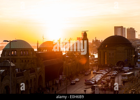 Sunset over the old Elbtunnel and the Landungsbruecken at the habour, Hamburg, Germany - Stock Photo