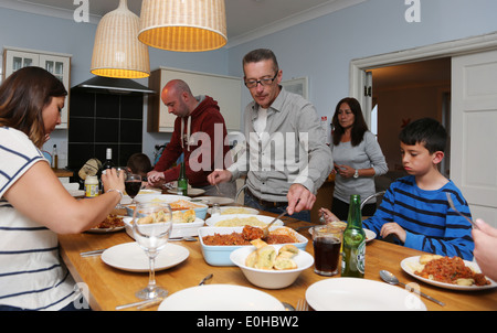 Large dinner party with friends & family - Stock Photo