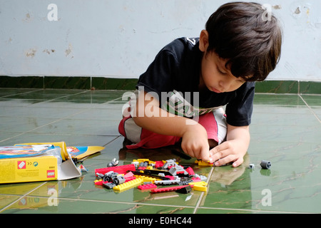 little boy playing with lego - Stock Photo