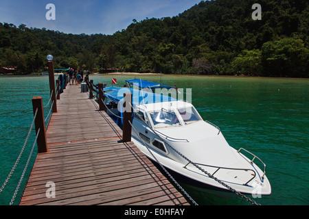 Snorkeling boat docked on the ISLAND OF PULAU GAYA in the TUNKU ABDUL RAHMAN PARK - SABAH, BORNEO, MALAYSIA - Stock Photo