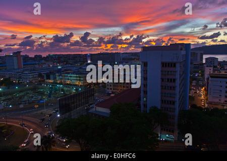 The skyline of the city of KOTA KINABALU at sunset - SABAH, BORNEO, MALAYSIA - Stock Photo