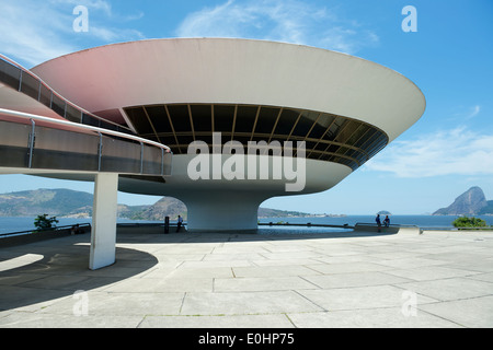 RIO DE JANEIRO, BRAZIL - FEBRUARY 4, 2014: The modernist Niteroi Contemporary Art Museum (MAC) by Oscar Niemeyer - Stock Photo