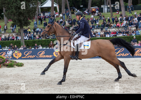 Ulrich Kirchhoff riding in the Furusiyya FEI Nations Cup show jumping competition at Piazza di Siena in Rome's Villa - Stock Photo