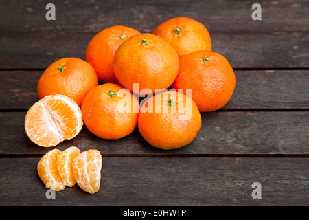 Mandarin oranges on a wooden table - Stock Photo