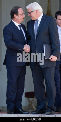 Paris, France. 14th May, 2014. German Foreign Minister Frank-Walter Steinmeier (R) shakes hands with French President - Stock Photo