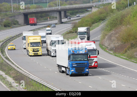 Trucks and other trafic traveling along the M20 motorway in Kent, England. - Stock Photo