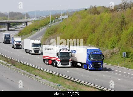 Trucks traveling along the M20 motorway in Kent, England. - Stock Photo