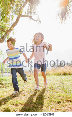 Children Having Fun In Countryside - Stock Photo