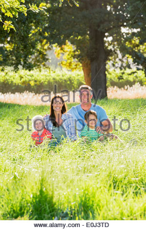 Family Enjoying Walk In Beautiful Countryside - Stock Photo