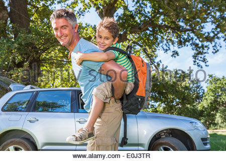 Father And Son Enjoying Walk In Countryside Trip - Stock Photo