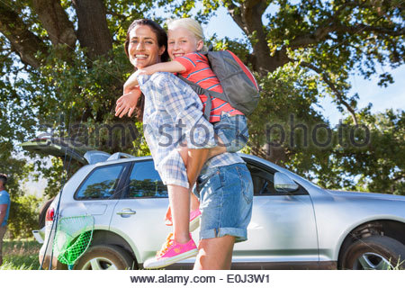 Mother And Daughter Enjoying Walk In Countryside Trip - Stock Photo