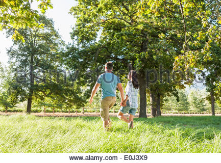 Romantic Couple Enjoying Walk In Beautiful Countryside - Stock Photo