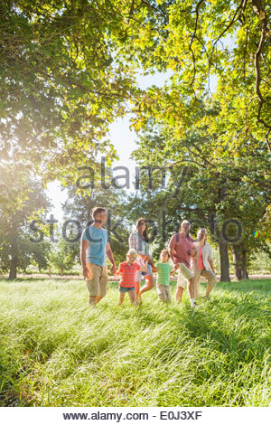 Multi-Generation Family Enjoying Walk In Beautiful Countryside - Stock Photo