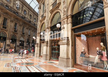 Prada Store in Galleria Vittorio Emanuele II shopping center in Milan, Italy with shoppers and tourists strolling - Stock Photo