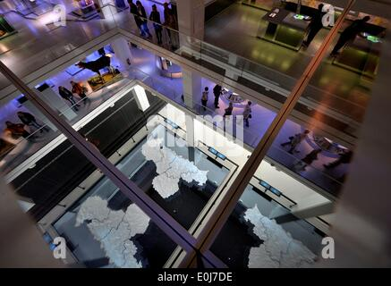 Chemnitz, Germany. 14th May, 2014. A day before the opening visitors walk through the different floors of the new - Stock Photo