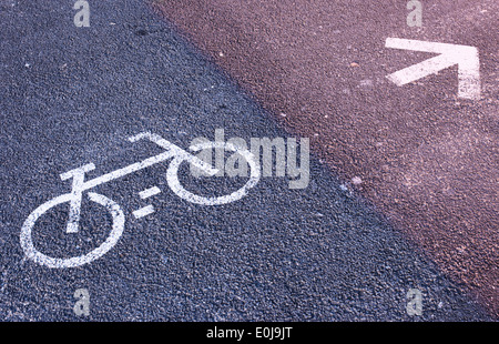 Sign painted on road indicating cycle lane. - Stock Photo