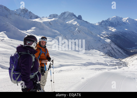 Two skiers on snow slopes in the French Alps at resort of Le Tour, Chamonix-Mont-Blanc, Haute Savoie, Rhone-Alpes, - Stock Photo