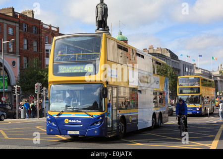 Double decker buses passing the Daniel O'Connell Monument in O'Connell Street, Dublin, County Dublin, Republic of - Stock Photo