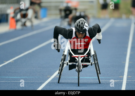 Marine Cpl. Anthony McDaniel wins the men's 200 meter wheelchair race during the 2013 Warrior Games track and field - Stock Photo