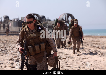 Marines and sailors from Combat Logistics Battalion 22, 22nd Marine Expeditionary Unit debark a landing craft air - Stock Photo