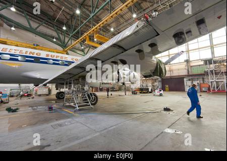 The historic passenger aircraft Lockheed Super Constellation L-1049 'HB-RSC' during maintenance in a hangar in Zurich/Kloten. - Stock Photo