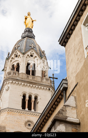 Virgin Mary atop the Basilica in Lyon - Stock Photo