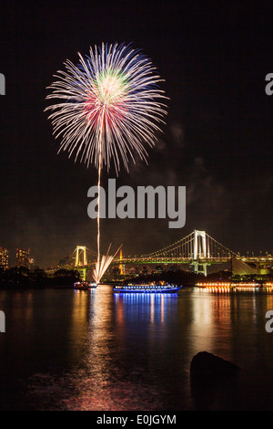 Fireworks over Tokyo bay at night in Japan - Stock Photo