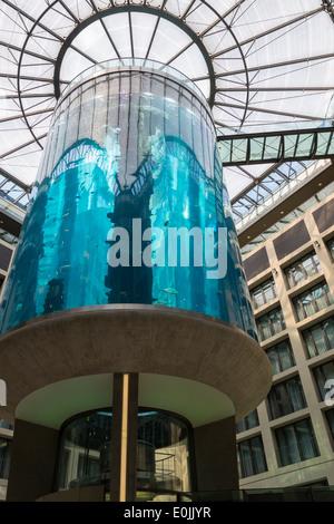 Massive blue aquarium in the Radisson Blu Hotel in Berlin, Germany. - Stock Photo