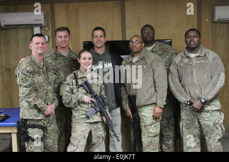Baltimore Ravens head coach John Harbaugh poses for a photo with service members at Kandahar Airfield's Morale, - Stock Photo