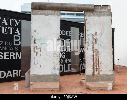 A section of the Berlin wall, on display, separated East and West Berlin, Germany during the Cold War. - Stock Photo