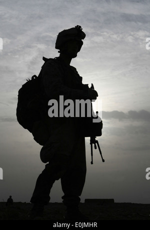A Marines with Charlie Company, 1st Battalion, 6th Marine Regiment, scans the horizon during a patrol through the - Stock Photo