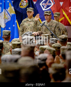 Gen. David Petraeus, commander of NATO International Security Assistance Force and U.S. Forces-Afghanistan, administers - Stock Photo