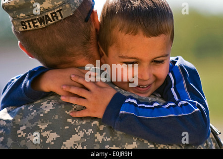 Staff Sgt. Patrick Stewart, infantryman from Terra Haute, Ind., holds his fiance's son at the 3-19th Agricultural - Stock Photo