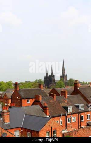 Lichfield Cathedral in Lichfield City Centre, Staffordshire, showing the roofs of the older buildings and the three - Stock Photo