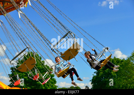 Home Park Windsor Berkshire England United Kingdom Girls Taking A Ride On The Swing Carousel At Royal Horse ShowWindsor