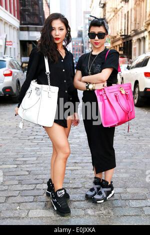 Sabrina Xin and Candy Zong walking in New York City - May 12, 2014 - Photo: Runway Manhattan/Charles Eshelman - Stock Photo