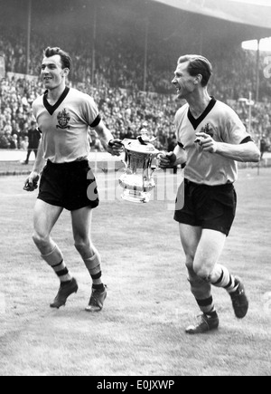 Eddie Clamp and Bill Slater of Wolverhampton Wanderers with FA Cup winners at Wembley in 1960 - Stock Photo