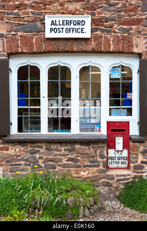 The Old Post Office and village shop with leaded light windows and postbox at Allerford on Exmoor, Somerset, United - Stock Photo