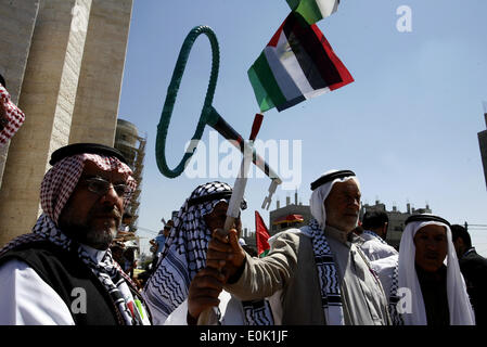Gaza, Palestinian Territories. 15th May, 2014. A Palestinians take part in a rally ahead of the 66th anniversary - Stock Photo