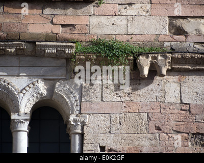 Bevagna, Umbria, Italy; detail of the facade of the Romanesque church of San Silvestro in Piazza Silvestri - Stock Photo