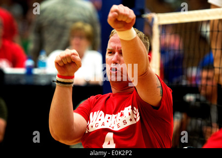 Gunnery Sgt. Bryce R. Keene, native of Winter Park, Fla., celebrates after spiking the ball for a point during a - Stock Photo