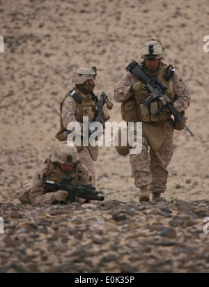 Marines from India Company, 3rd Battalion, 6th Marine Regiment, hike up a rocky hill in Helmand province, Afghanistan, - Stock Photo