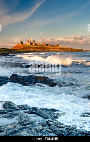 Dunstanburgh Castle viewed from the south, Near Craster, Northumberland, England, UK - Stock Photo