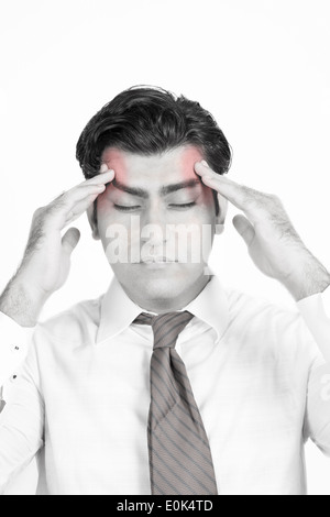 Man suffering from a head ache isolated on white background, black and white portrait. - Stock Photo