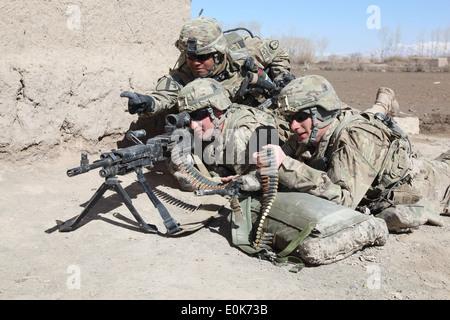 U.S. Army Sgt. 1st Class Anthony Saldivar (left), from San Antonio Texas, of 2nd Platoon, D Company, 3rd Battalion, - Stock Photo