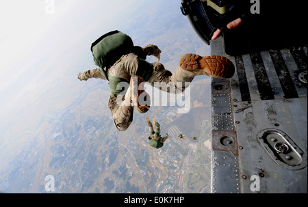 A pararescueman from the 31st Rescue Squadron freefalls with a parachute after jumping from a 33rd Rescue Squadron - Stock Photo