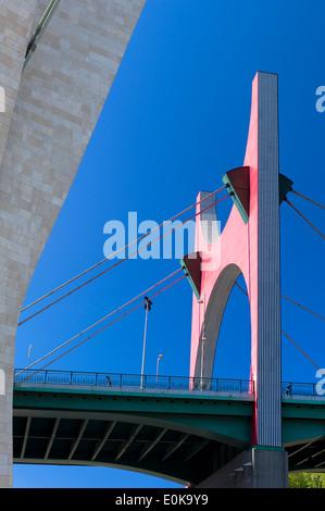 The Red arches by artist Daniel Buren at La Salve Bridge by Juan Batanero in Bilbao in Basque country, Spain