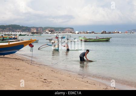 Scenery of Ekas Bay seen from area of Ekas, Lombok, Indonesia - Stock Photo