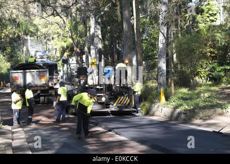 road resurfacing works in progress in a street in sydney,australia - Stock Photo